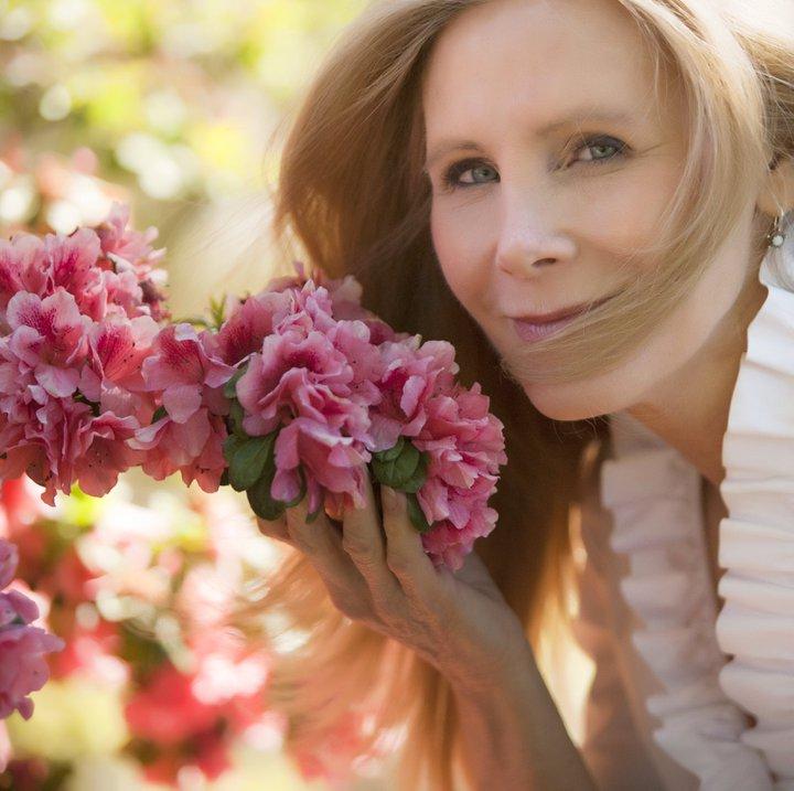 Nancy smelling flowers at arburetum 227168_10150196459294033_5187961_n