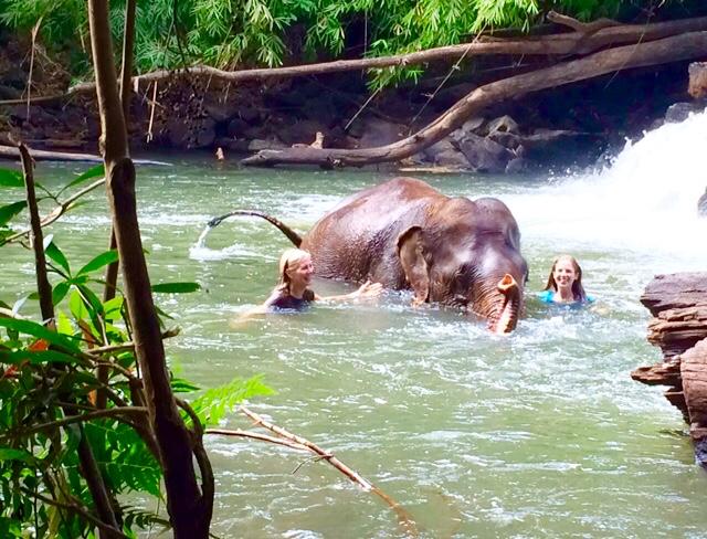 Nancy Addison in water w elephant and daughter amanda in cambodia FullSizeRender(10) copy