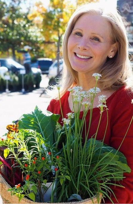 nancy at farmer's market w plants by Nick
